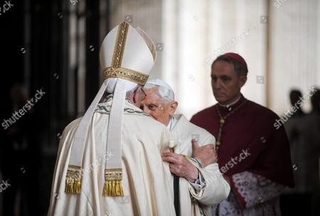Pope Francis I hugs Pope emeritus Pope Benedict XVI in St. Peter's Basilica
