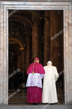 Pope emeritus Pope Benedict XVI enters through the Holy Door of St. Peter's Basilica