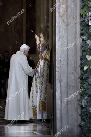 Pope Francis I waits for Pope Emeritus Pope Benedict XVI who is passing through the Holy Door of St. Peter's Basilica