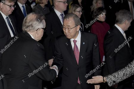 Secretary-General of the United Nations Ban Ki-moon and Former Finnish President, founder and chairman of Crisis Management Initiative CMI Martti Ahtisaari (l) shake hands during the celebration of the 60th anniversary of Finland's UN membership