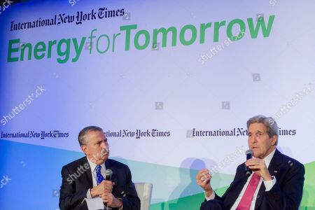 Stock Picture of John Kerry chats with New York Times columnist Thomas Friedman During Panel on Sidelines of COP21 Climate Change Conference