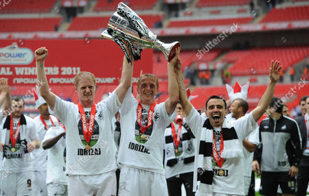 Alan Tate, Garry Monk and Leon Britton of Swansea City celebrate winning the Championship Play-Off Final.