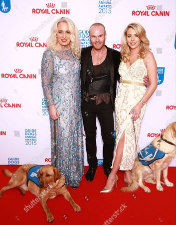 Debbie Douglas, Philip Baldwin and Lydia Bright on the red carpet accompanied by guide dog puppies, at the London Hilton on Park Lane. The Guide Dogs Annual Awards celebrates the life-changing work of the charity.
