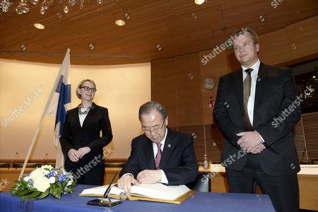 United Nations Secretary General Ban Ki-moon (C) meets the Speaker of the Parliament of Finland Maria Lohela (L) and Member of Finnish Parliament Antti Kaikkonen (R) in Helsinki