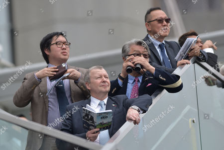 (2nd L) Mr Winfried Engelbrecht-Bresges, Chief Executive Officer of The HKJC watches the action during The Longines Hong Kong International Races at Sha Tin Racecourse in Hong Kong. Pic: Hugh Routledge. 13.12.15