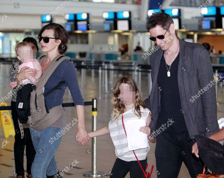 Milla Jovovich with daughters Dashiel Edan Anderson and Ever Gabo and Paul W.S. Anderson