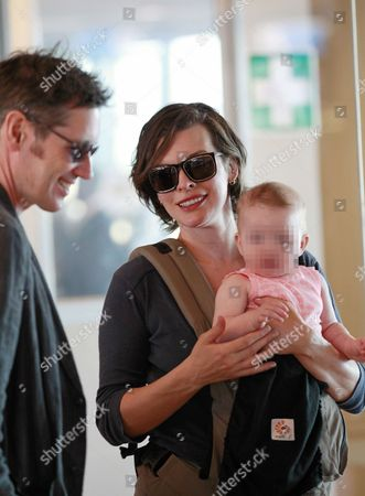 Editorial picture of Milla Jovovich and family at Cape Town Airport, South Africa - 10 Dec 2015