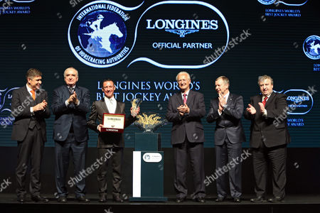 Frankie Dettori, winner of the LONGINES World's Best Jockey Award ceremony. From right: Brian Kavanagh, Vice-Chairman (Europe) of the IFHA; Winfried Engelbrecht-Bresges, Vice-Chairman (Asia) of the IFHA and Chief Executive Officer of the Hong Kong Jockey Club; Louis Romanet, Chairman of IFHA; Frankie Dettori ; Walter von KÃnel, President of LONGINES; and Juan-Carlos Capelli, Vice President of LONGINES, at the Longines World's Best Jockey Award ceremony, Hong Kong, China