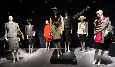 Various outfits including a Black and white Houndstooth tweed coat and brimmed sloping hat - £400 - 600