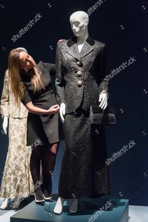 A Black Cocktail Suit by Tomasz Starzewski, 1995.  2,000-3,000