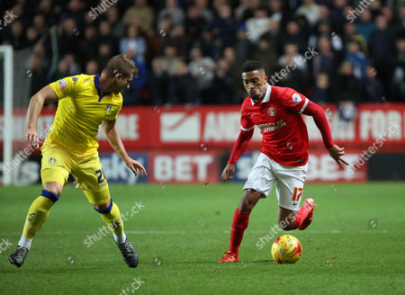 Stock Picture of Charlton Athletic defender Tareiq Holmes-Dennis taking on Leeds United defender Gaetano Berardi during the Sky Bet Championship match between Charlton Athletic and Leeds United at The Valley, London