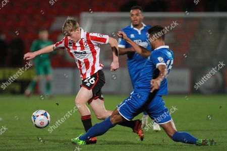 Luke Thomas and Damien Green during the FA Trophy match between Cheltenham Town and Chelmsford City at Whaddon Road, Cheltenham