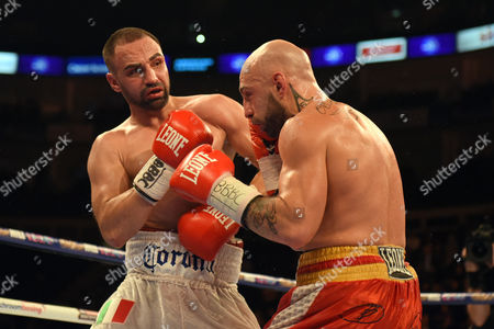 Stock Image of Paul Malignaggi (white shorts) defeats Antonio Moscatiello to win the vacant EBU Welterweight Title at the O2 Arena, London
