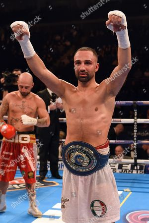 Stock Picture of Paul Malignaggi (white shorts) defeats Antonio Moscatiello to win the vacant EBU Welterweight Title at the O2 Arena, London