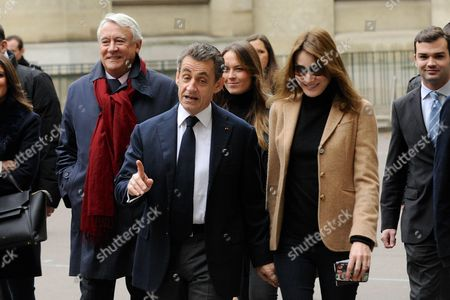 Mayor of the 16th Paris District Claude Goasguen, Former French President, who is also the current Chief of the French right-wing opposition Les Republicains (LR) party President Nicolas Sarkozy and his wife Carla Bruni-Sarkozy voting for second round of the Regional Elections of the Ile de France Region at 'Lycee La Fontaine'