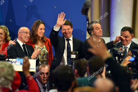 Christian Estrosi, French Deputy, mayor of Nice and French right-wing Les Republicains (LR) party's top candidate for the regional election in the Provence-Alpes-Cote d'Azur region, celebrates his victory with Eric Ciotti (L), French Deputy and President of the Department Council of the 'Alpes Maritimes', Maud Fontenoy and French Deputy, Renaud Muselier (2-R) for the second round of the regional election in the PACA region