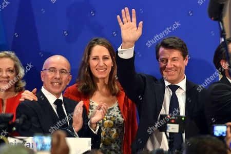 Christian Estrosi, French Deputy, mayor of Nice and French right-wing Les Republicains (LR) party's top candidate for the regional election in the Provence-Alpes-Cote d'Azur region, celebrates his victory with Eric Ciotti (L), French Deputy and President of the Department Council of the 'Alpes Maritimes', and Maud Fontenoy for the second round of the regional election in the PACA region