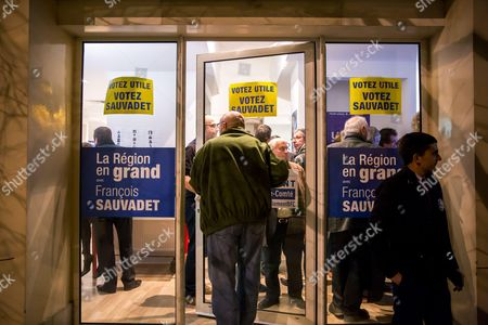 Supporters enter the headquarters during the results of the second round of the French regional election 2015 in the bourgogne France conte region