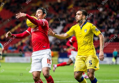 Reza Ghoochannejhad of Charlton Athletic controls on his chest as Giuseppe Bellusci of Leeds United defends during the Sky Bet Championship match between Charlton Athletic and Leeds United.