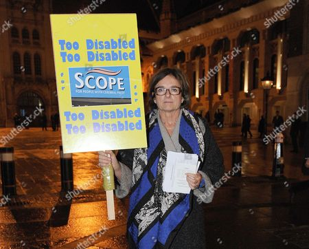 Rosa Monckton Holds A Placard Outside Guildhall Art Gallery Against Scope. Protesters Have Gathered Outside To Hand Out Leaflets To The People Attending The Ball To Advise Them Of Scope Who Are Closing Care Homes That Will Mean Almost 200 Middle-aged Disabled People Will Be Re-homed. City Of London  UK  25/11/2014.
