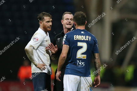 Referee Mr Kevin Wright has words with Joe Garner and  Neal Eardley  after the two clash during the SKY BET Championship Match between Preston North End and Birmingham City played at Deepdale, Preston on 15th December 2015