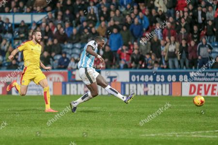 Stock Photo of Ishmael Miller (Huddersfield Town) shoots to score Huddersfields second of the game during the Sky Bet Championship match between Huddersfield Town and Rotherham United at the John Smiths Stadium, Huddersfield