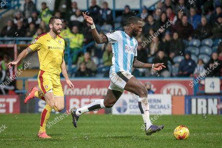 Stock Image of Ishmael Miller (Huddersfield Town) through on goal and scores the second for Huddersfield during the Sky Bet Championship match between Huddersfield Town and Rotherham United at the John Smiths Stadium, Huddersfield