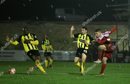 Jake Robinson of Whitehawk has a shot during the FA Cup Second Round Replay match between Whitehawk and Dagenham & Redbridge played at The Enclosed Ground, Brighton on 15th December 2015
