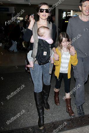 Stock Photo of Milla Jovovich, Paul W.S. Anderson, Ever Gabo and Dashiel Edan