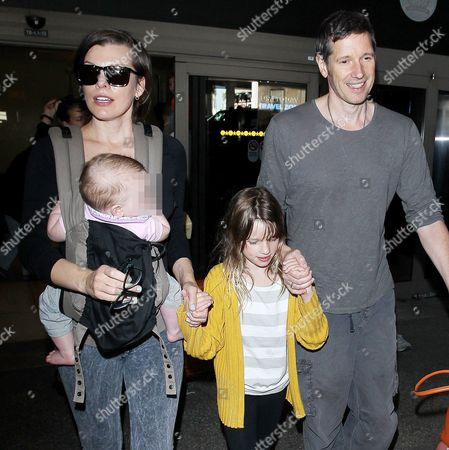 Editorial image of Milla Jovovich at LAX international airport, Los Angeles, America - 16 Dec 2015