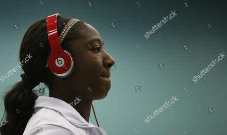 Kadeen Corbin warms up wearing Beats by Dre headphones