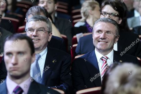 IOC President Thomas Bach sits by Sergey Bubka, President of the National Olympic Committee of Ukraine, Member of the IOC Executive Board