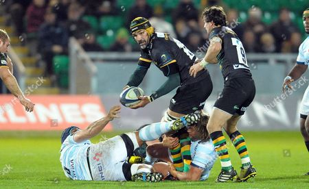 Northampton's Victor Matfield though tackled by two Racing 92 players off loads the ball - Rugby Union - European Champions Cup - Northampton Saints v Racing 92 - 18/12/15 - Round 4 - At Franklin's Gardens, Northampton UK