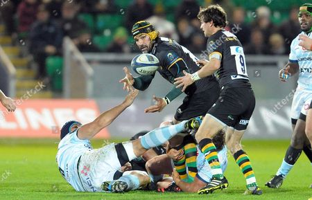 Northampton's Victor Matfield though tackled by two Racing 92 players off loads the ball to Lee Dickson (9) - Rugby Union - European Champions Cup - Northampton Saints v Racing 92 - 18/12/15 - Round 4 - At Franklin's Gardens, Northampton UK