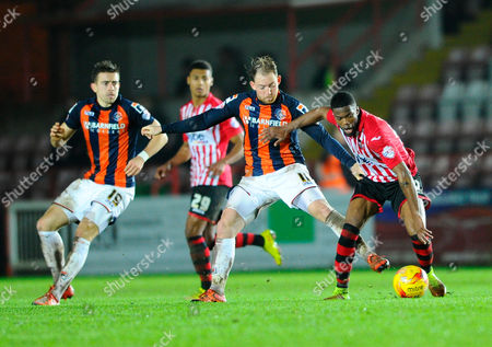 Luton Town's Danny Green and Exeter City's Joel Grant during the Sky Bet League 2 match between Exeter City and Luton Town at St James' Park, Exeter
