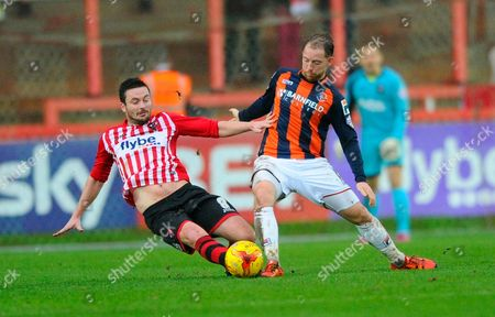 Exeter City's Matt Oakley and Luton Town's Danny Green during the Sky Bet League 2 match between Exeter City and Luton Town at St James' Park, Exeter