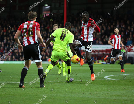 Brentford midfielder Toumani Diagouraga dispossesing Hudderfield Town striker Ishmael Miller after a Hudderfield Town chance during the Sky Bet Championship match between Brentford and Huddersfield Town at Griffin Park, London