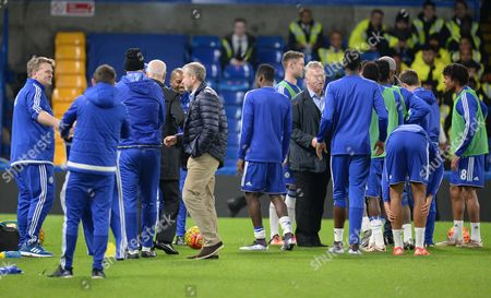 Stock Photo of Owner Roman Abromovich and manager Guus Hiddink greet players and staff on the pitch during the Barclays Premier League match between Chelsea and Sunderland played at Stamford Bridge, London on 19th December 2015
