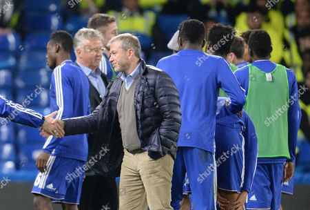 Owner Roman Abromovich and manager Guus Hiddink greet players and staff on the pitch during the Barclays Premier League match between Chelsea and Sunderland played at Stamford Bridge, London on 19th December 2015