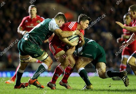 Leicester's Marcos Ayerza and Michael Fitzgerald with Ian Keatley of Munster