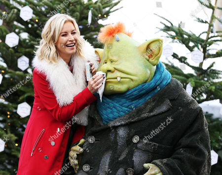 """London's commuters were surprised and delighted to see Raymond Briggs' character Fungus come to life and venture above ground in London, and even do a spot of Christmas shopping with celebrity Denise Van Outen, to mark the launch of Sky 1's hotly anticipated family drama Fungus the Bogeyman.   A 7ft Fungus was spotted at locations across the capital, in Victoria station, crossing the Millennium Bridge and taking in the Christmas sights of the capital in the company of one of TV's biggest stars.   Bringing Raymond Briggs' much-loved creation to life, a prosthetic Fungus costume was commissioned and operated by a specialist movement actor. A specialist team of eight took approximately three weeks to create the life-like costume.   The stunt was orchestrated by Sky 1 to celebrate the launch of its funktacular family drama Fungus the Bogeyman, which premieres at 6pm on 27th December.   The three part series boasts a mixture of live action and animation that brings Fungus to life on screen. The cast includes BAFTA nominated Timothy Spall in the title role, as he and his family of Bogeymen navigate our 'above ground' world, frightening humans along the way. Further cast includes Victoria Wood, Joanna Scanlan, Keeley Hawes and Marc Warren with Andy Serkis narrating.   Fungus was also spotted with Denise Van Outen strolling down the Southbank, enjoying a hot chocolate and taking a spin on a carousel.  The popular TV and radio presenter, who has starred in EastEnders and on the West End stage, was also runner up on Strictly Come Dancing in 2012.   Denise Van Outen said: """"I'm probably lucky Fungus didn't make me stop by his house for a cup of mould wine, but actually he was a real charmer and I had a great time roaming the streets with him. He insisted on paying for my hot chocolate like a true Bogey-gentleman, and I'll certainly be pointing my daughter in the direction of the TV when he hits our screens this Christmas."""""""