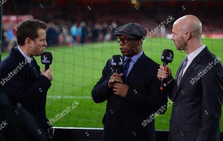 L-R Mark Pougatch, Ian Wright and Danny Mills during the Barclays Premier League match between Arsenal and Manchester City played at The Emirates Stadium, London on December 21st 2015