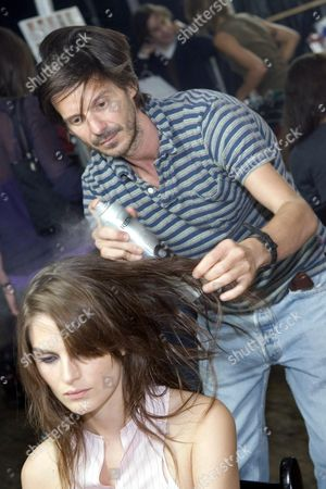 Stock Picture of Hair stylist Guido Palau backstage at Marc Jacobs