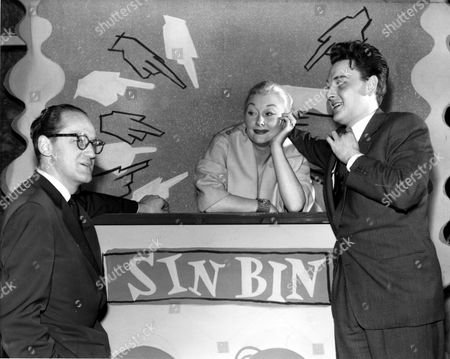 Bob Monkhouse, Christine Norden and husband on ' Bury your Hatchet ' game show - 1957.