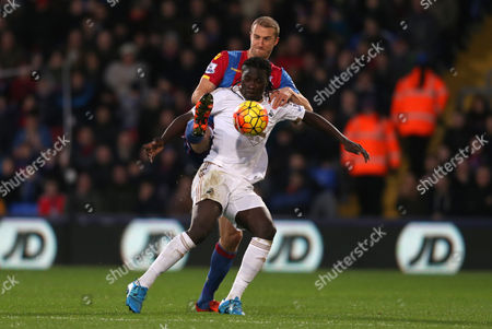 Bafetibis Gomis of Swansea City backs into Brede Hangeland of Crystal Palace during Crystal Palace vs Swansea City at Selhurst Park