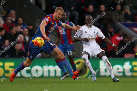 Modou Barrow of Swansea City drinks a ball past Brede Hangeland of Crystal Palace during Crystal Palace vs Swansea City at Selhurst Park