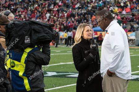 CBS's Allie LaForce interviews Interviews Miami's Larry Scott, Interim Head Coach