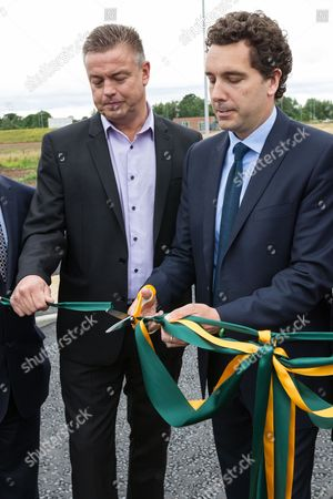 Ian Mills (L) and Edward Timpson MP open the new Basford West Spine Road, Crewe. It is to be named Jack Mills Way after the late local train driver and grandfather of Mr Mills, who was attacked during the Great Train Robbery in 1963.