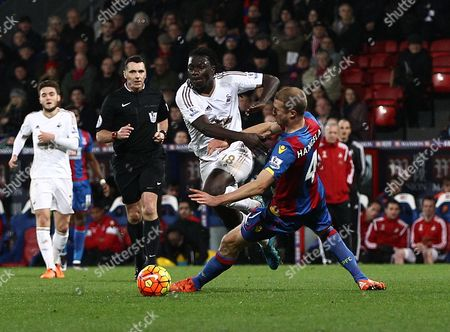 Bafetimbi Gomis of Swansea is fouled by Brede Hangeland of Crystal Palace   during the Barclays Premier League match between Crystal Palace and Swansea  played at Selhurst Park on 28th December 2015 in London