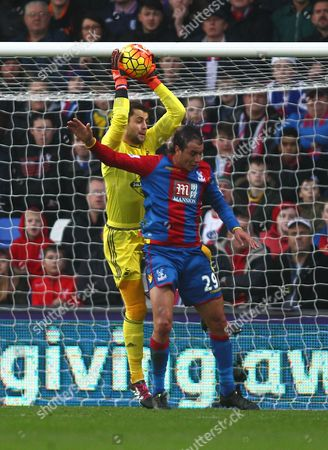 Lukasz Fabianski of Swansea gathers the ball under pressure from Marouane Chamakh of Crystal Palace   during the Barclays Premier League match between Crystal Palace and Swansea  played at Selhurst Park on 28th December 2015 in London